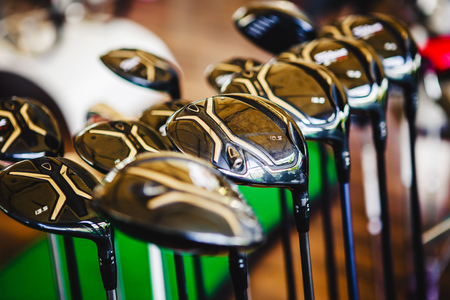Photo for A shiny metal golf clubs for sale show in shop rack. - Royalty Free Image
