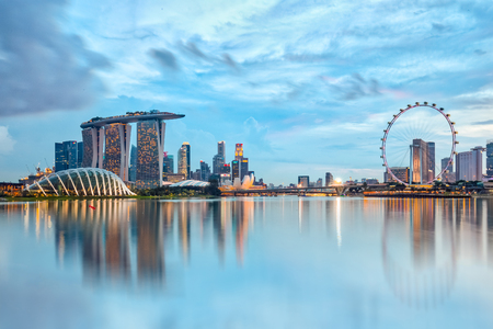 Foto de Singapore City, Singapore - July 17, 2015: Marina Bay is a bay near Central Area in the southern part of Singapore, and lies to the east of the Downtown Core. The area surrounding the bay itself, also called Marina Bay - Imagen libre de derechos