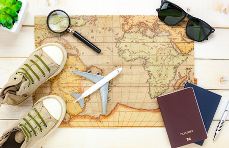 Photo pour Top view essential travel items.The notebook tree map passport airplane shoe sunglasses on white  wooden background. - image libre de droit