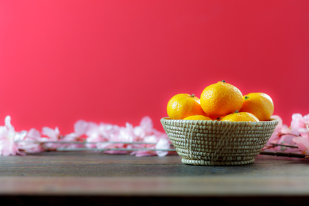 Photo for shot of accessories Chinese new year & decoration Lunar festival concept background.beautiful arrangement orange & items on modern rustic wood red wallpaper.Sign essential object for the decor season. - Royalty Free Image
