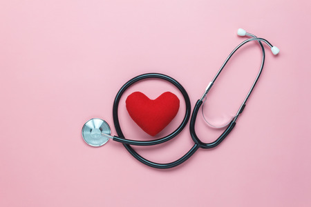 Photo pour Table top view shot of arrangement equipment medical background concept.Red heart & stethoscope on modern rustic pink paper.An idea essential accessories for doctor for  care patient  in hospital. - image libre de droit