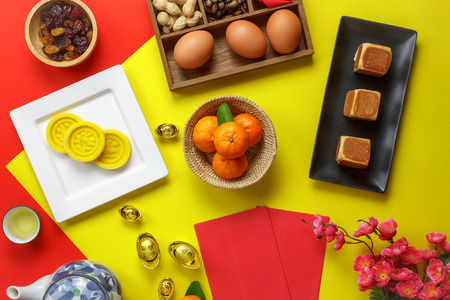 Photo pour Table top view aerial image of accessories and Chinese new year and Lunar new year festival concept background.Mix variety object for the season.Difference items on modern red & yellow.pastel tone. - image libre de droit