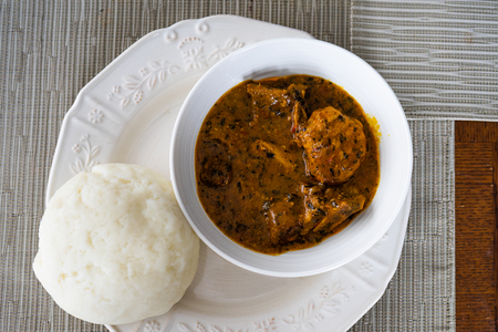 Photo for Nigerian Ogbono Soup Served with Pounded Yam - Royalty Free Image