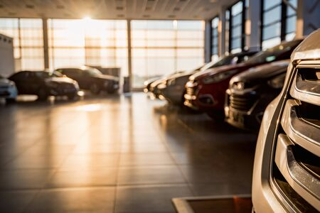 Foto de New cars at sunlit dealer showroom close view - Imagen libre de derechos