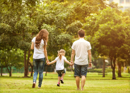 Photo for Family walk in the park, happy at sunset in Bangkok, Thailand. - Royalty Free Image