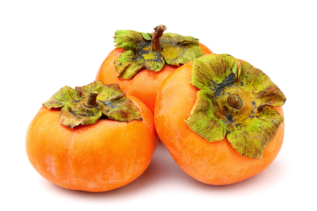 Photo for Ripe persimmons isolated on white background close-up. - Royalty Free Image