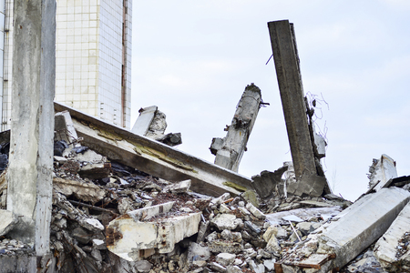 Photo for Remains of the destroyed industrial building. Large concrete piles continue to hold the body of the large concrete buildings, while others look at the sky. - Royalty Free Image