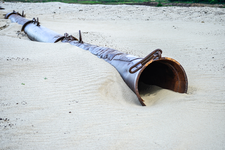 Photo for The remains of the pipe washing the sand in a sand quarry - Royalty Free Image