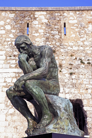 Photo for copy of the thinker of rodin of the typical south east of france old stone village of saint paul de vence on the french riviera refuge of many artist,painters,sculptors - Royalty Free Image
