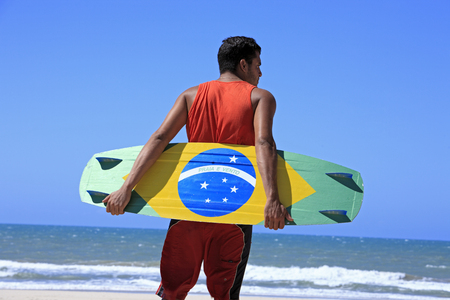 Photo for Kite surfer with the brazilian flag painted on the board with  - Royalty Free Image
