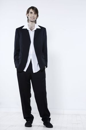 Photo for studio shot portrait of a young funny expressive thin and tall man on isolated background - Royalty Free Image