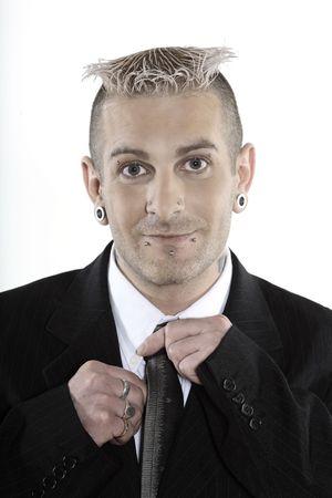 Foto de studio shot of isolated picture of a strange caucasian businessman with piercing and tattoos - Imagen libre de derechos