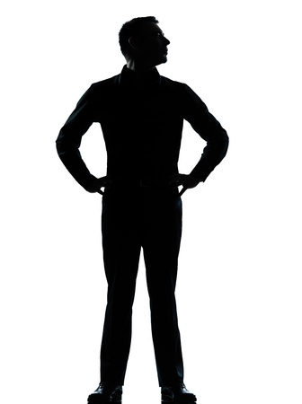 Photo for one caucasian business man silhouette standing hands on hips Full length in studio isolated on white background - Royalty Free Image