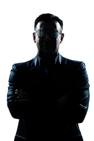 one caucasian man portrait silhouette serious arms crossed strange glasses in studio isolated white background