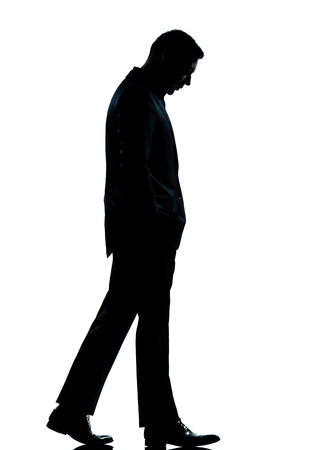 Photo for one caucasian business man walking silhouette Full length in studio isolated on white background - Royalty Free Image