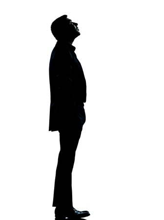 Photo for one caucasian business man silhouette standing looking up Full length in studio isolated on white background - Royalty Free Image