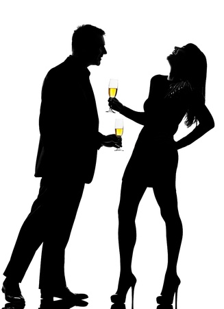 Photo for one caucasian couple man and woman drinking flirting partying in studio silhouette isolated on white background - Royalty Free Image