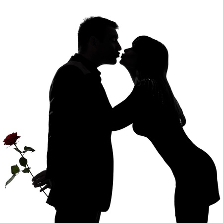 Photo for one caucasian couple man and woman kissing in studio silhouette isolated on white background - Royalty Free Image