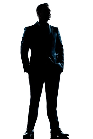 Photo pour one caucasian  business man  handsome full suit standing full length serious silhouette in studio isolated white background - image libre de droit