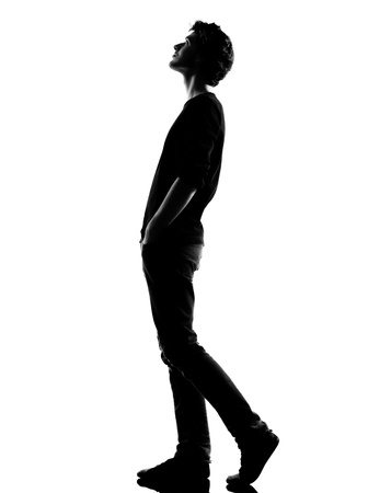 Photo for young man  walking looking up silhouette in studio isolated on white background - Royalty Free Image