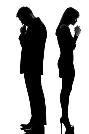 Photo for one caucasian sad couple back to back man thinking and woman crying standing back to back man and woman in studio silhouette isolated on white background - Royalty Free Image