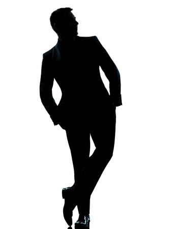 one caucasian business man silhouette standing Full length hands in pocket in studio isolated on white background