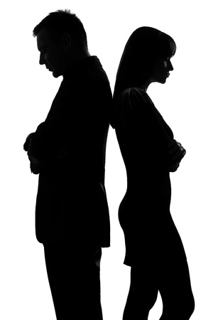Photo for one caucasian couple standing back to back man and woman sad in studio silhouette isolated on white background - Royalty Free Image