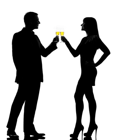 Photo for one caucasian couple man and woman drinking champagne toasting partying in studio silhouette isolated on white background - Royalty Free Image