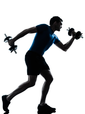 Foto de one caucasian man exercising weight training workout fitness in silhouette studio  isolated on white background - Imagen libre de derechos