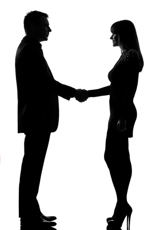 Photo for one caucasian couple man and woman handshake in studio silhouette isolated on white background - Royalty Free Image