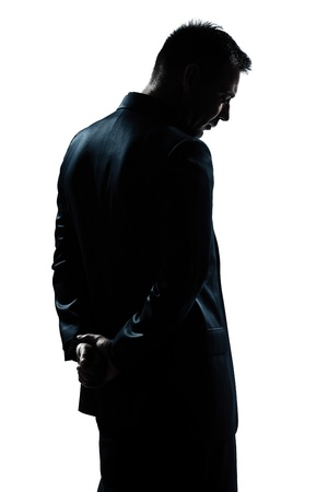 Photo for one caucasian man portrait silhouette backside sad despair lonely in studio isolated white background - Royalty Free Image