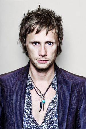 Photo for PARIS, FRANCE - JULY 04, 2012  Portrait of the english rock group Muse drummer Dominic Howard at Paris, France on july 4th, 2012 - Royalty Free Image