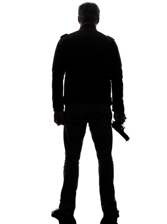 Photo for one man killer policeman holding gun silhouette rear view studio white background - Royalty Free Image