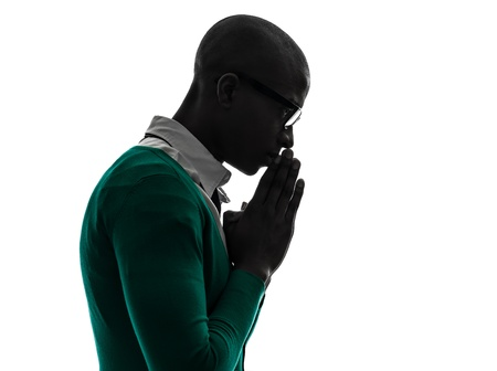 Photo for one african  black man  thinking pensive praying silhouette  in silhouette studio on white background - Royalty Free Image
