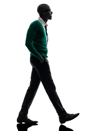 Photo for one african  black man walking in silhouette studio on white background - Royalty Free Image