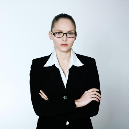 Photo pour studio shot portrait of one caucasian young serious business woman - image libre de droit