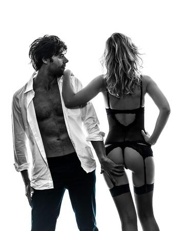 Photo pour sexy stylish couple  caucasian in silhouette on white background - image libre de droit