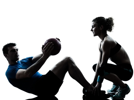 Photo for one caucasian couple man woman personal trainer coach exercising weights fitness ball silhouette studio isolated on white background - Royalty Free Image