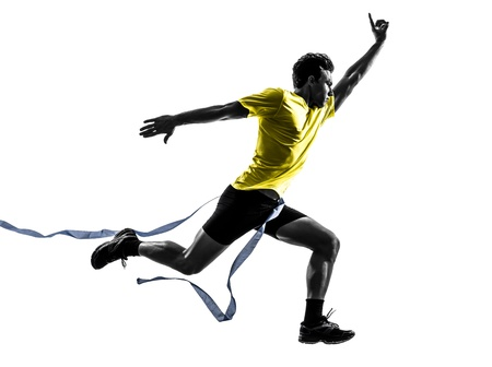 Photo for one caucasian man young sprinter runner running  winner at finish line  in silhouette studio  on white background - Royalty Free Image