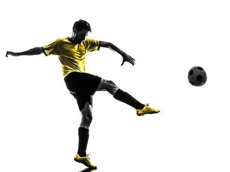 Foto de one brazilian soccer football player young man kicking in silhouette studio  on white background - Imagen libre de derechos