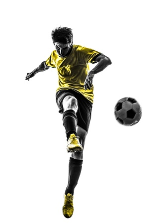 Photo pour one brazilian soccer football player young man kicking in silhouette studio  on white background - image libre de droit