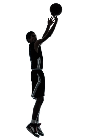 Foto de one young man basketball player silhouette in studio isolated on white background - Imagen libre de derechos