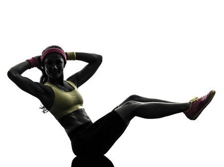 Photo pour one  woman exercising crunches fitness workout arms behind head in silhouette  on white background - image libre de droit
