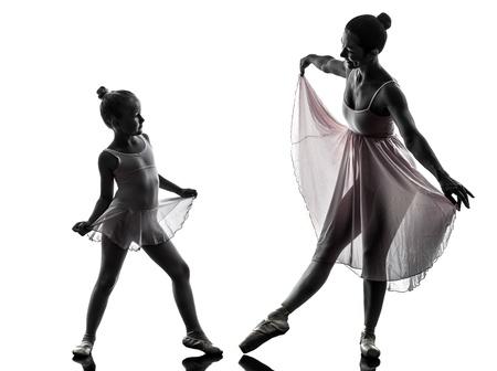 Foto de woman and  little girl   ballerina ballet dancer dancing in silhouette on white background - Imagen libre de derechos