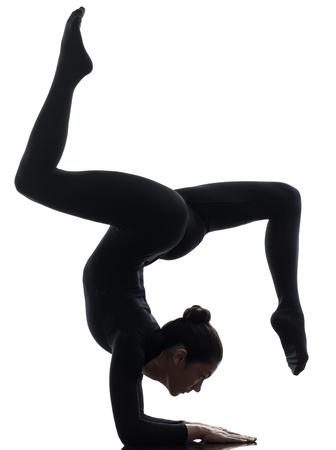 Photo pour one caucasian woman contorsionist practicing gymnastic yoga  in silhouette   on white background - image libre de droit