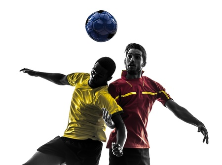 Photo pour two men soccer player playing football competition fighting for a ball in silhouette on white background - image libre de droit