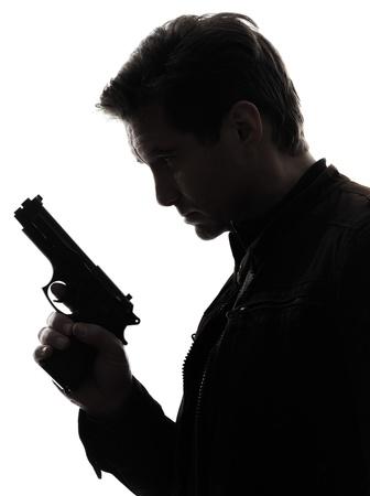 Photo pour one man killer policeman holding gun portrait silhouette studio white background - image libre de droit
