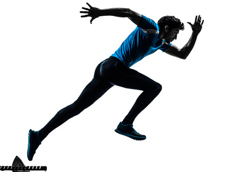 Foto de one caucasian man  running sprinting jogging in silhouette studio isolated on white background - Imagen libre de derechos