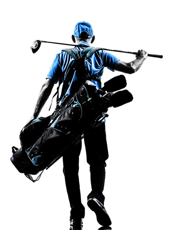 Photo for one man golfer golfing golf bag walking  in silhouette studio isolated on white background - Royalty Free Image