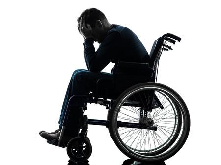 Foto de one handicapped man head in hands in silhouette studio  on white background - Imagen libre de derechos